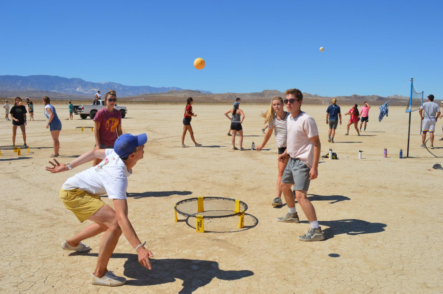 Biola students enjoy activities such as spikeball during the Johnson Valley camping trip.