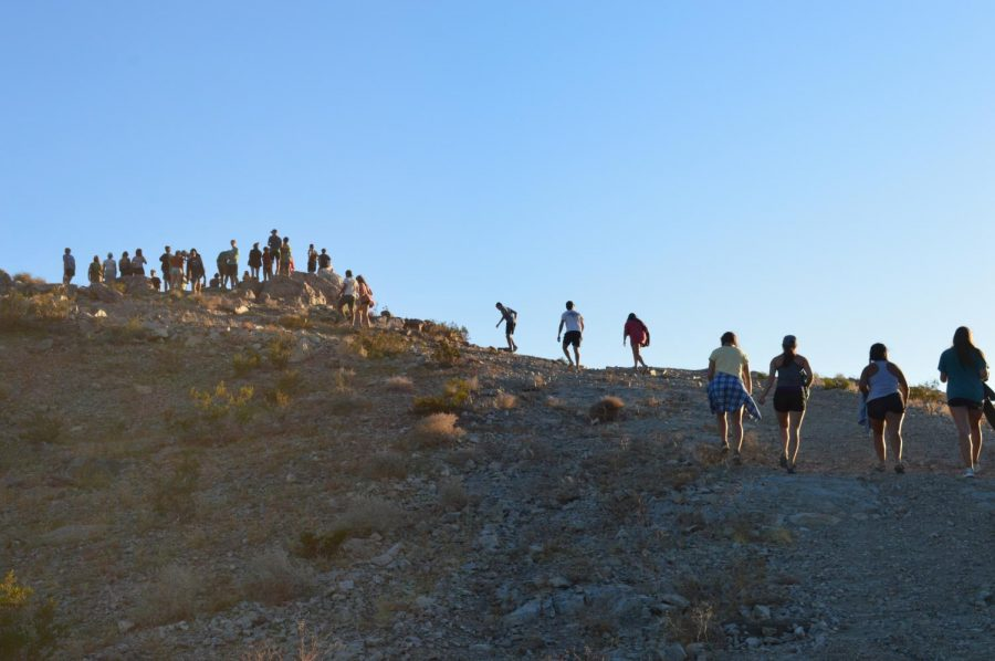 Students make their way up a hill to watch sunset during the Johnson Valley camping trip.