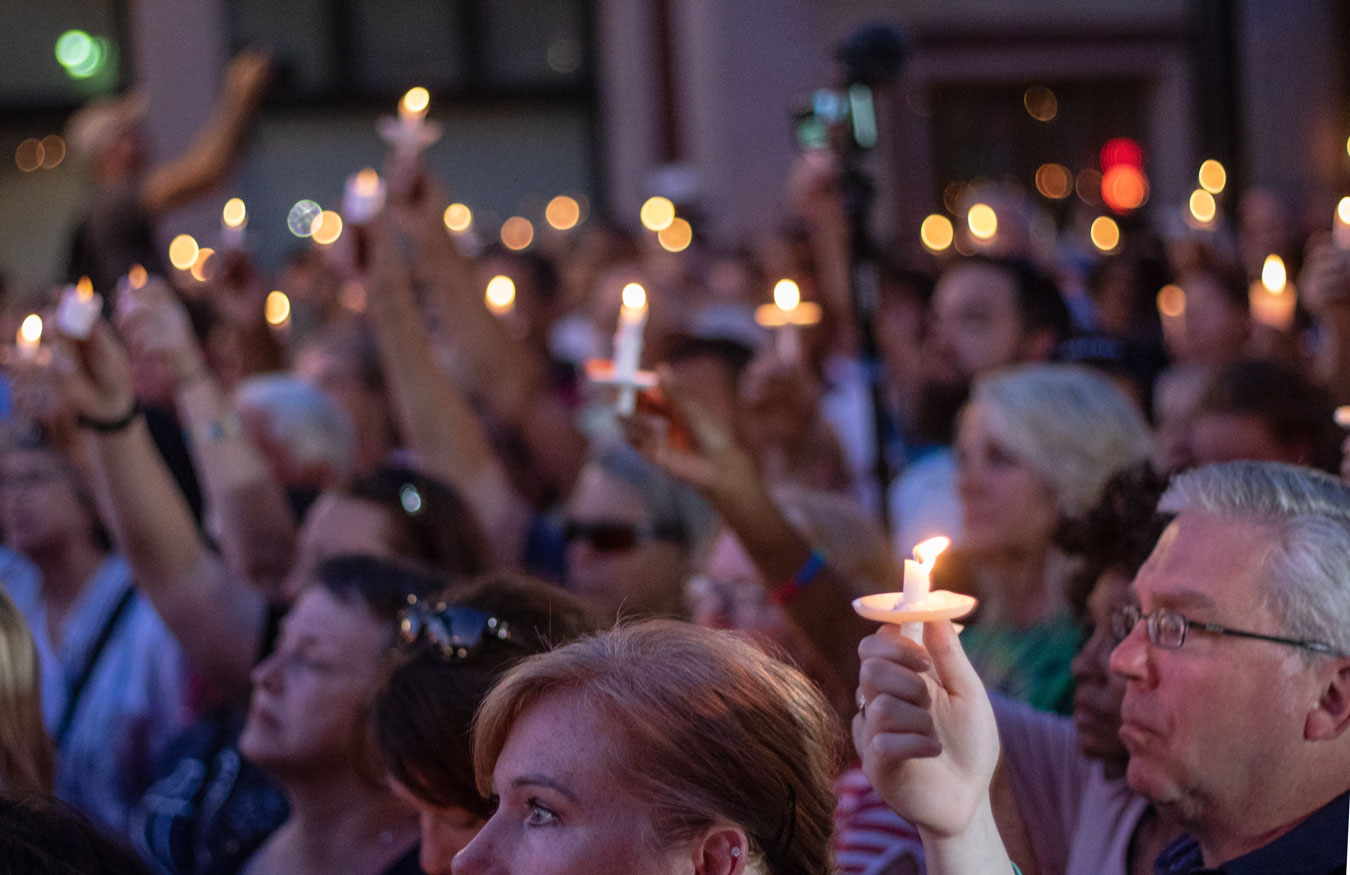 Residents of Dayton, Ohio hold a vigil for victims of the Dayton shooting that occurred last August.