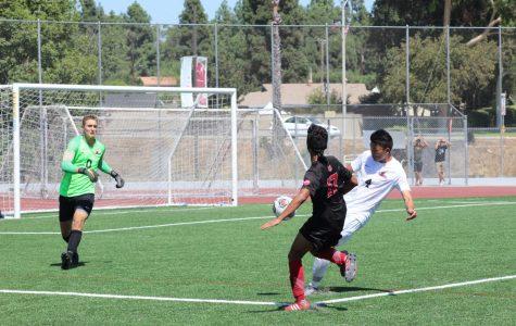 Sophomore midfielder Oscar Rubalcava attempts to score against the opposing team.