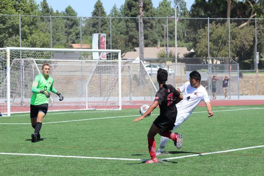 Sophomore midfielder Oscar Rubalcava attempts to score against the opposing team.