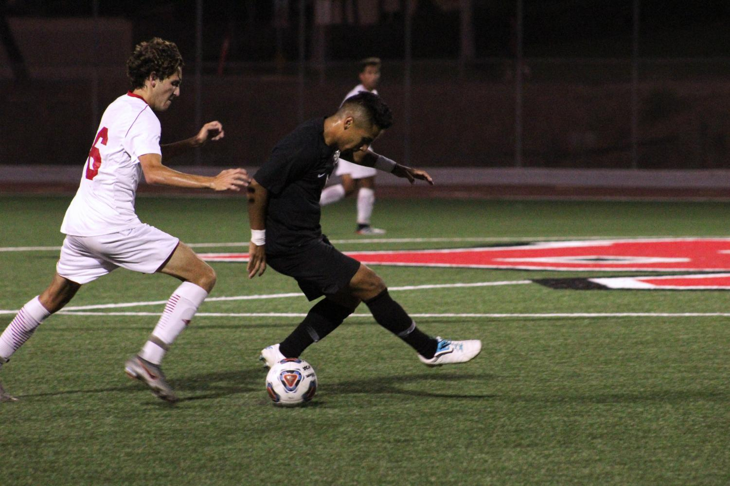 Freshman midfielder Chad Sinclair attempts to steal the ball from his opponent, during the game against California State University San Marcos on September 11, 2019.