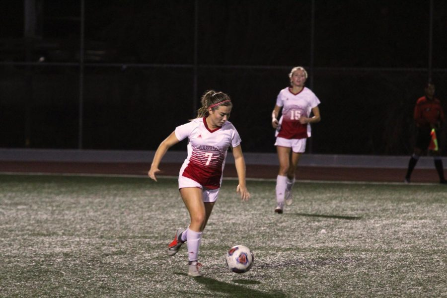 Senior defender Alyssa Chavez dribbles the ball.
