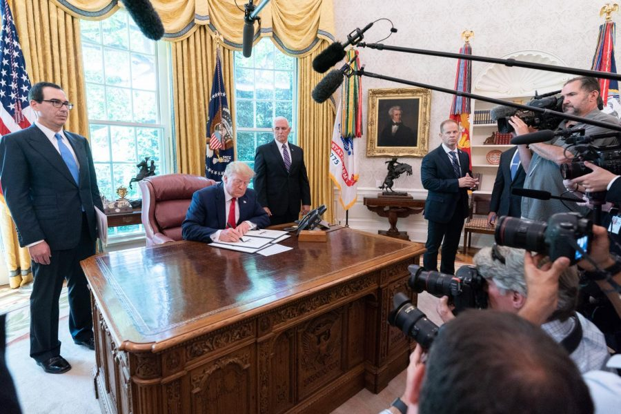 President Donald Trump signs an EO Sanctioning Iran.