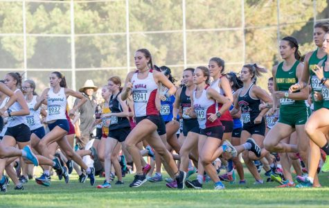 Biola Women's Cross Country team takes off at the start of their race.