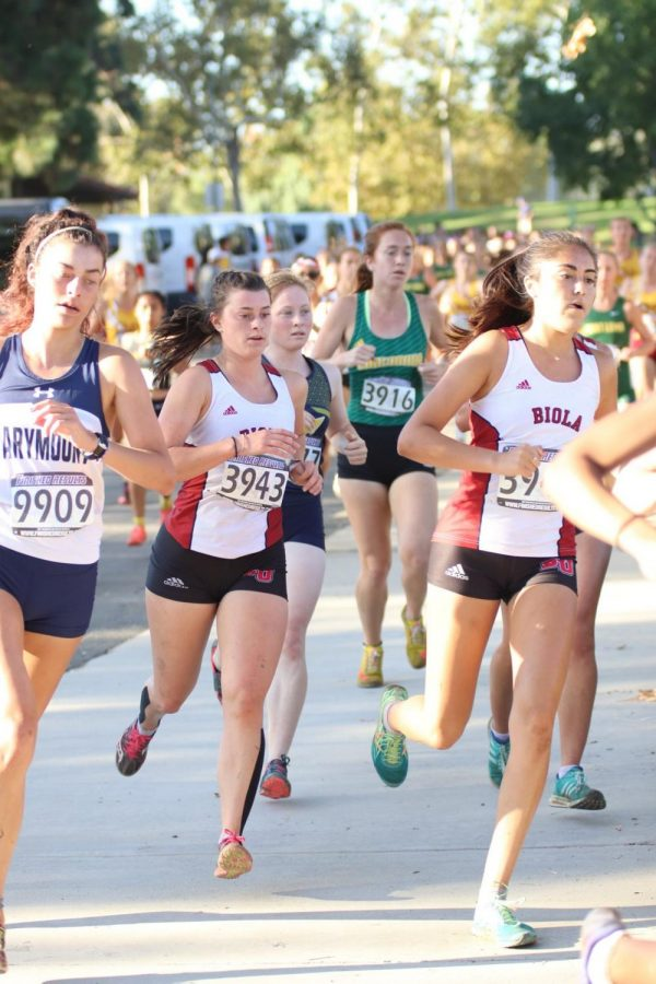 Two Biola runners pace their way towards the finish line.
