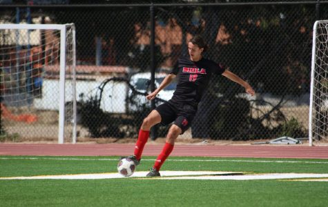 Senior defender Jake Munivez controls the ball against his opponents.