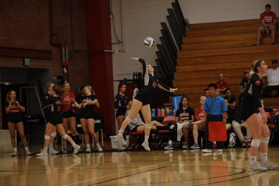 Kaitlin O'Brien, senior libero, serves the ball.