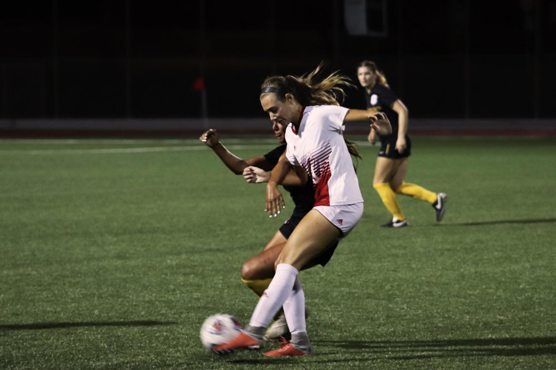 Freshmen forward, Christine Goodman steals the ball from her opponent.