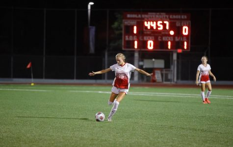 Senior Defender Colie Martin kicks the ball.