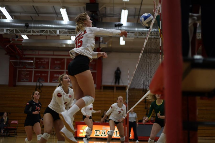 Senior outside hitter Becca Branch spikes the ball forcefully over the net for one of many kills she's had this season.