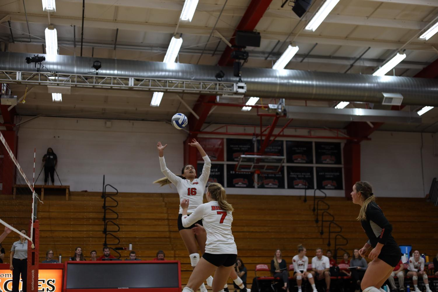 Junior Vanessa Garcia jumps towards the ball in order to pass towards her teammate.