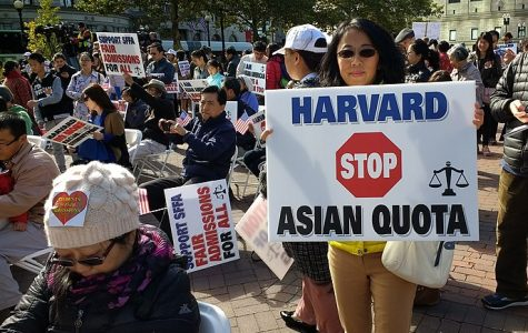 Asian Americans protest implementing affirmative action processes at Harvard University, as unfair standards discriminate against minorities.