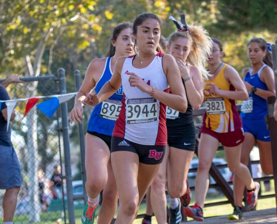 Biola cross country runner runs ahead of her opponents.