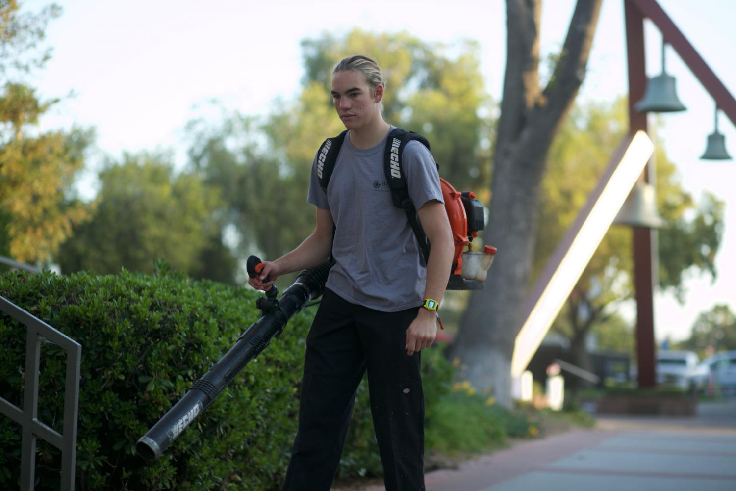 Sophomore Kinesiology major Evan Peters works a morning shift with a leaf blower - a shift he will not have for long.
