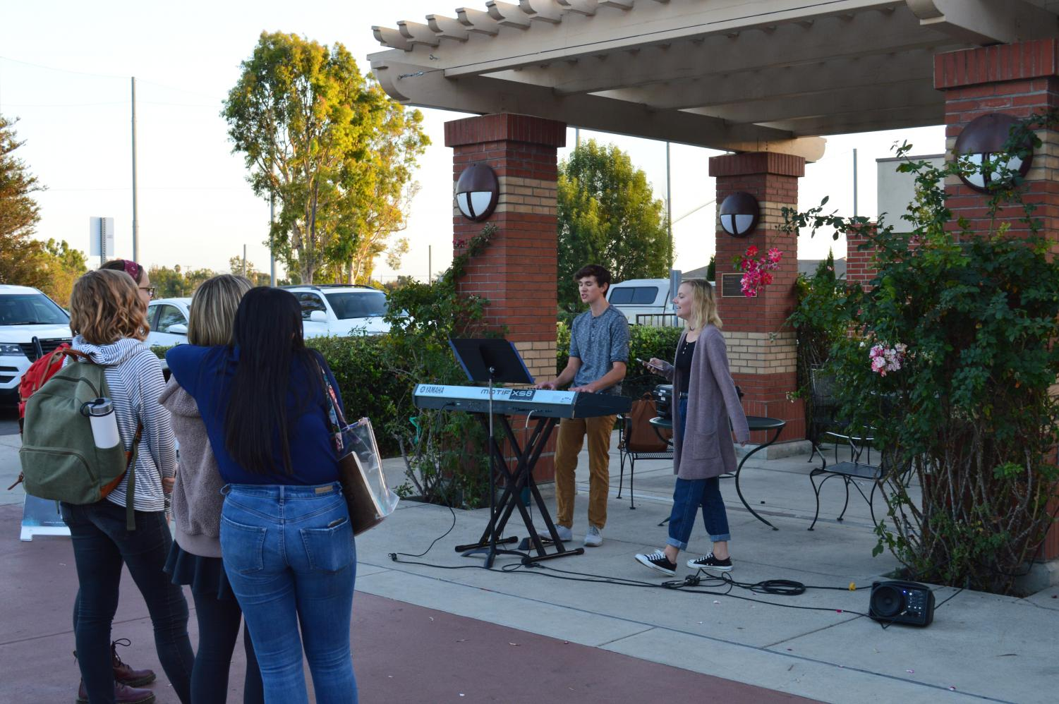 Freshmen commercial music majors Connor Martin and Hope Langston perform covers.