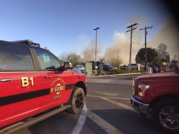 Fullerton Fire under control after burning less than two acres, police say
