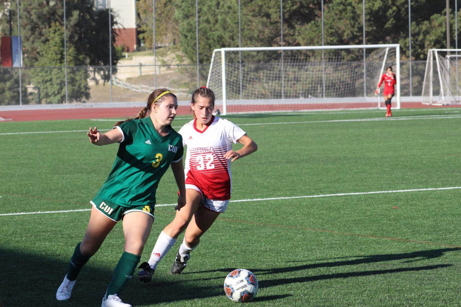 Freshman defender Madi Reeves moves in, in attempt to take the ball from her opponent.  During the October 2, 2019 match against Concordia University Irvine.
