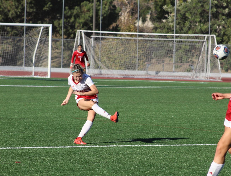 Senior Alyssa Chaves punts the ball.