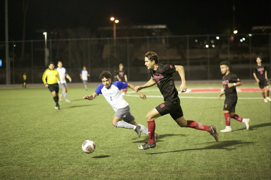 Senior defender Jake Munivez races to the ball against his opponent from Chaminade Hawaii University during their game on October 31, 2019.