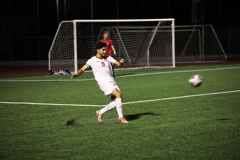 Senior defender, Alejandro Pelayo, kicks the ball away from the Biola goal.