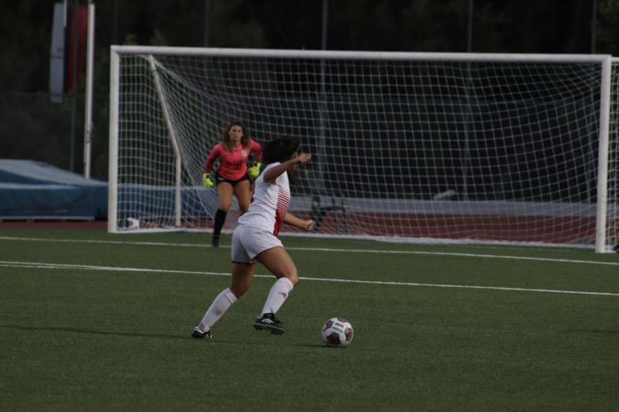 Senior Forward, Sarah Yang, gets ready to kick the ball into the goal.