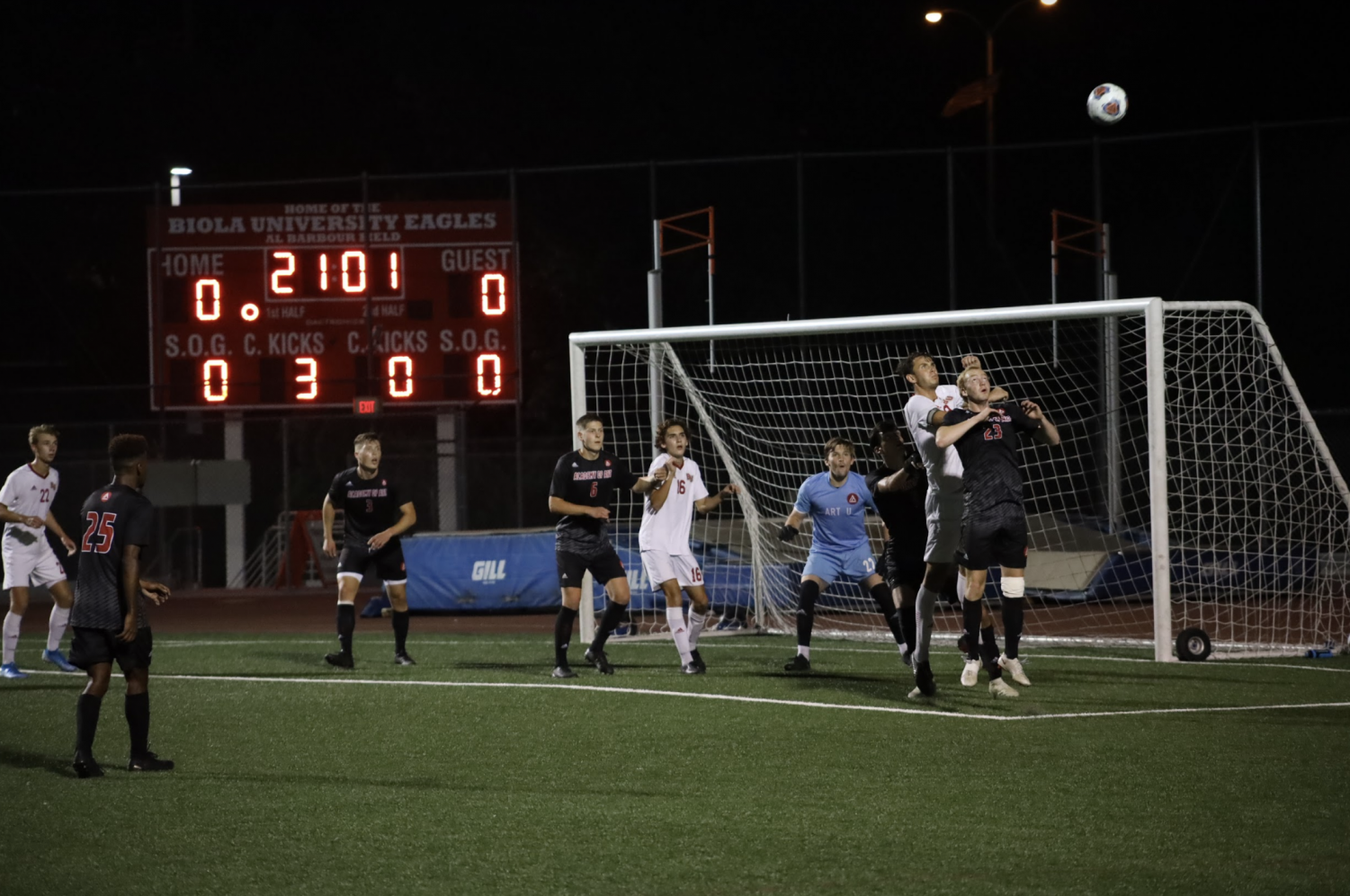 The Biola men's soccer team tries to get the ball into the net after a corner kick.