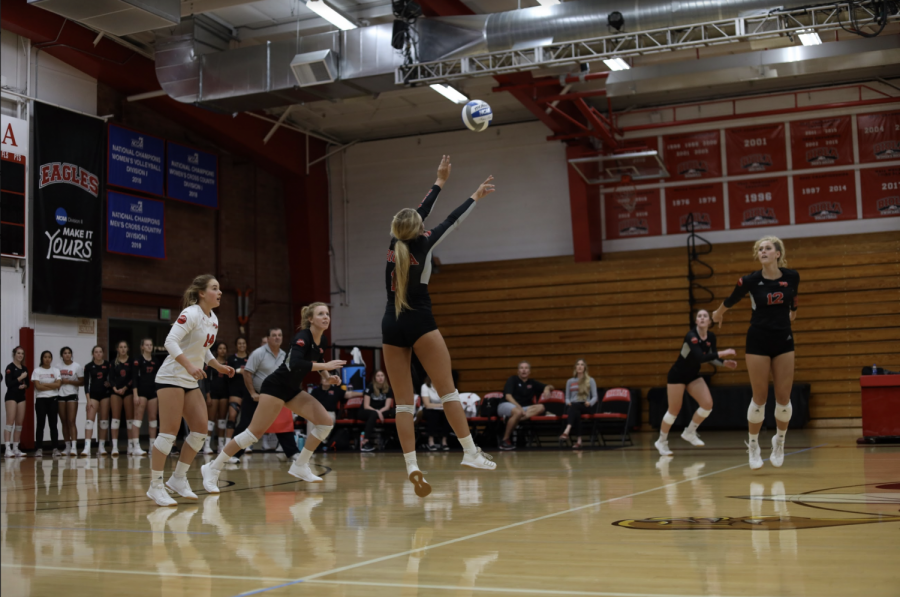 Biola's volleyball team passes the ball to each other in hopes to score a point.