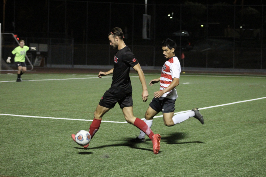 Senior Leo Thompson dribbles the ball towards the goal.