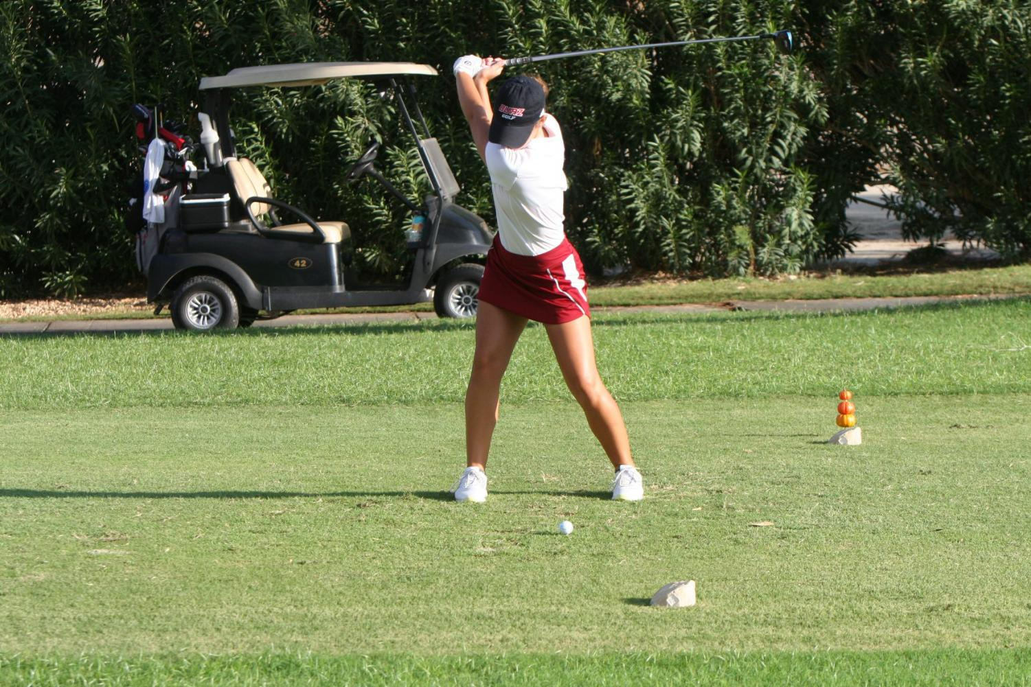 Biola golfer swings at the ball during the Sonoma State Invite.