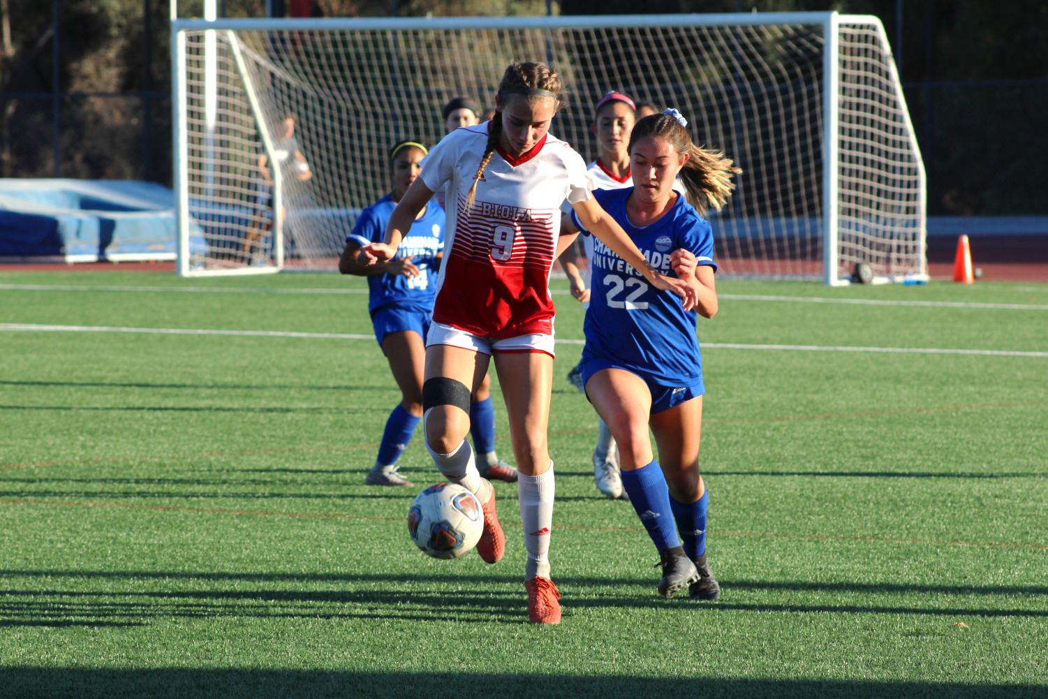 Freshman Christine Goodman, Forward, dribbles the ball away from her opponent during their game against Chaminade Hawaii University on October 31, 2019.