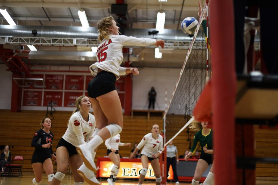 Senior outside hitter Becca Branch hits the ball over the net.