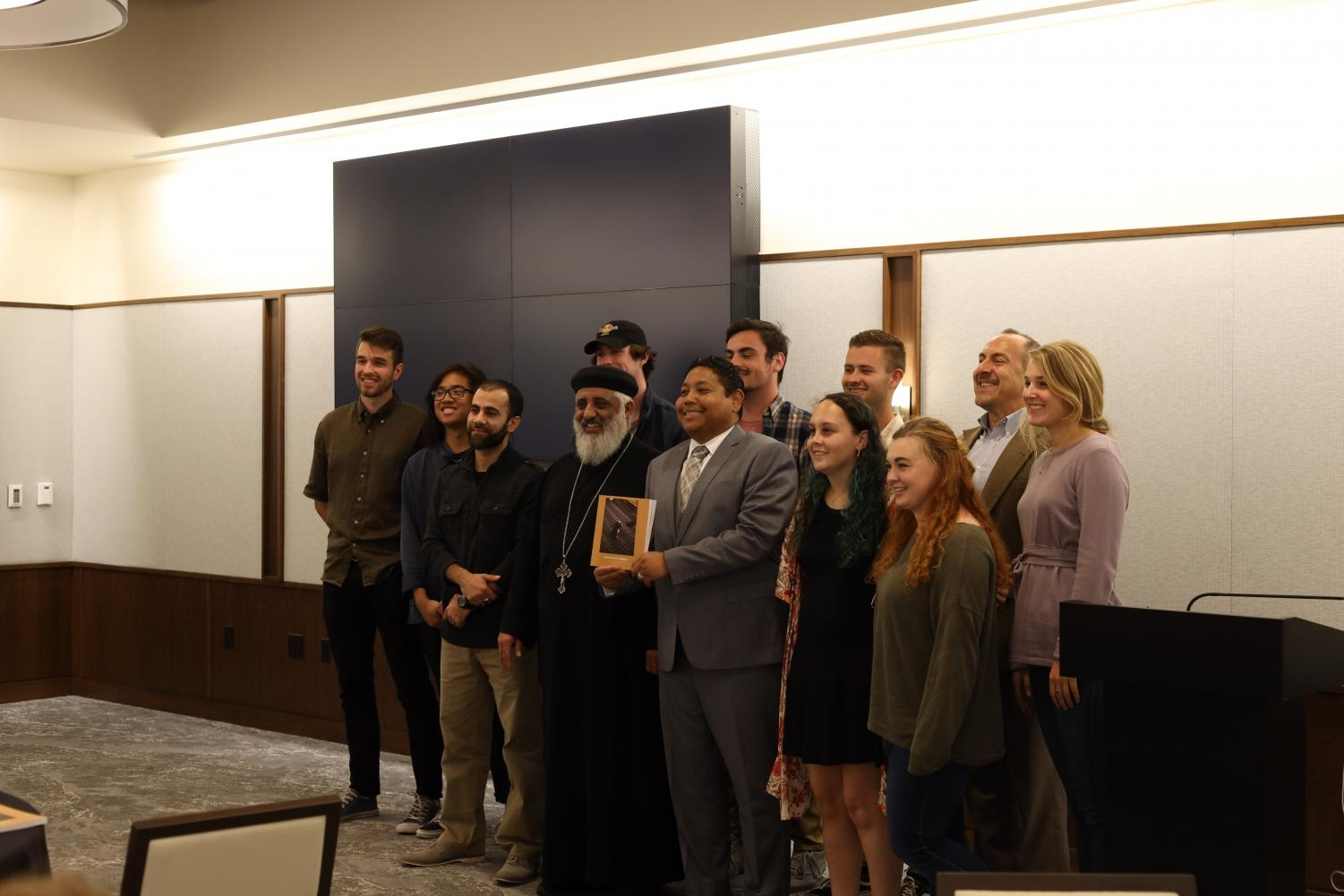 """Journalism students present their newly published book, """"Newcomers to Neighbors."""""""