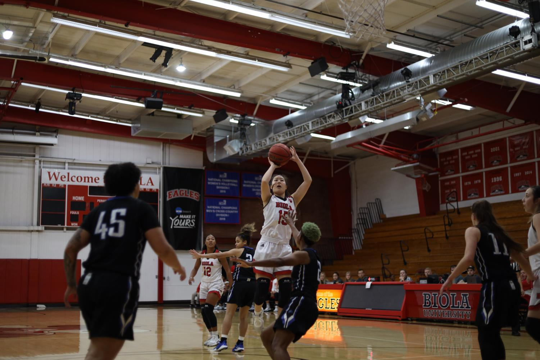 Freshmen guard Stephanie Lee jumps to make a basket.