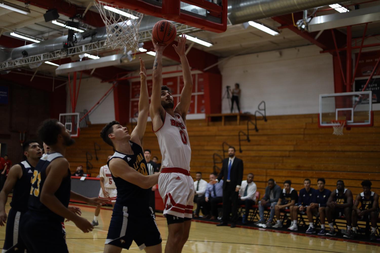 Junior guard Michael Bagatourian jumps to make a basket.