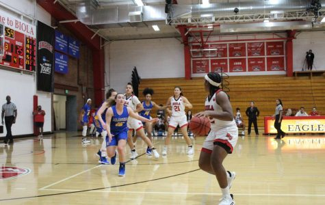 Senior guard Jelissa Puckett looks for a teammate to pass to during their game against Alaska Fairbanks on November 14th, 2019.
