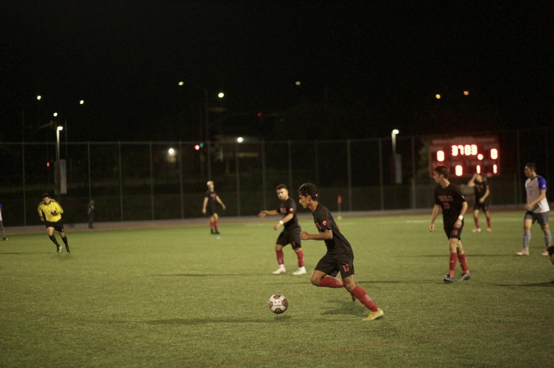 Sophomore Oscar Rubalcava dribbles the ball down the field.