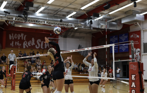 Freshman Abby Brewster goes in for the spike.
