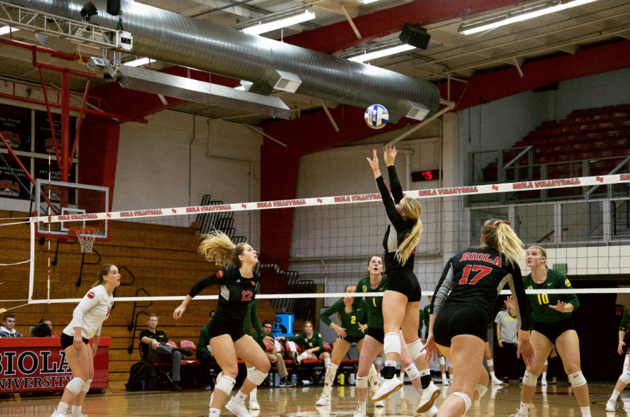 Biola's volleyball team goes in for a strike.