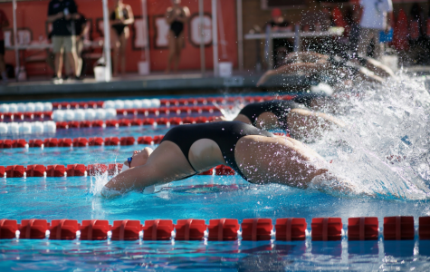 Biola women dive into the backstroke race.