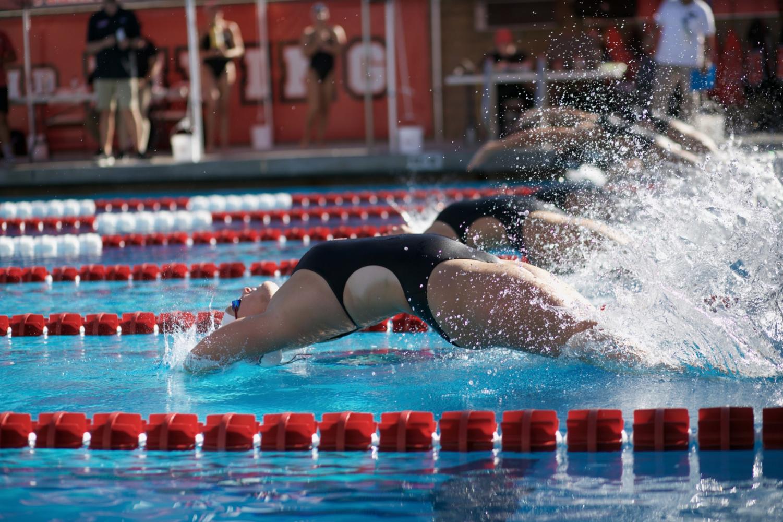 Biola women dive into the backstroke race.