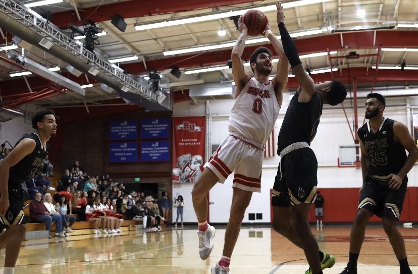Men's basketball bounces back against NDNU