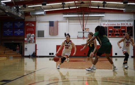 Freshman guard Stephanie Lee dribbles the ball up the court against Point Loma.