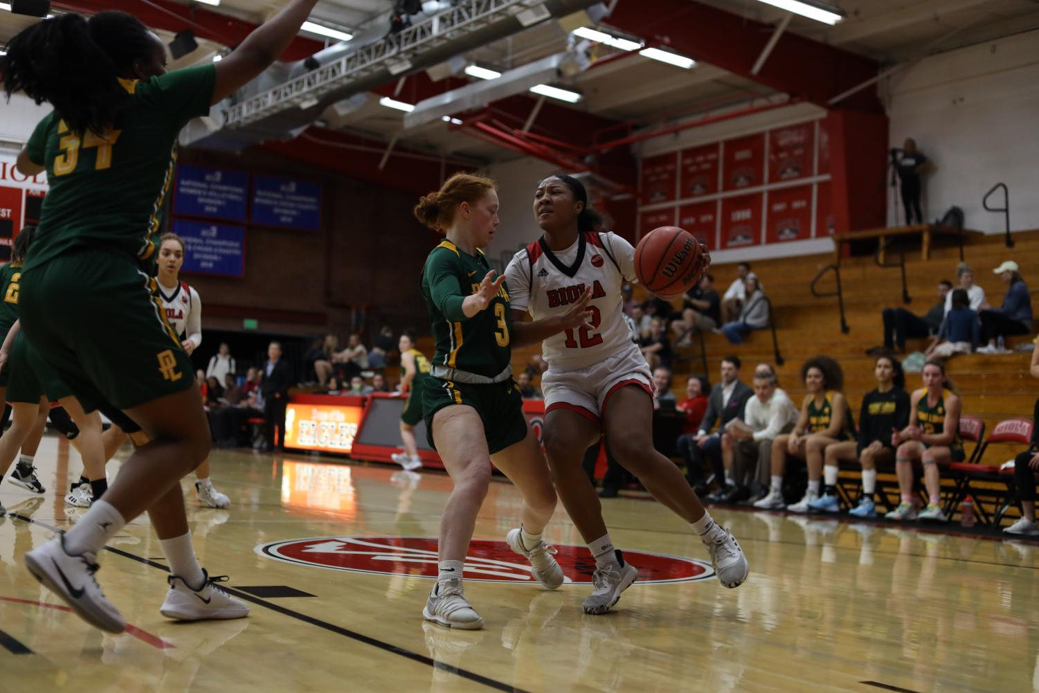 Sophomore guard Aysia Johnson blocks her opponent from the ball.