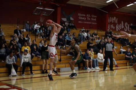 Men's basketball soars to win over Holy Names University