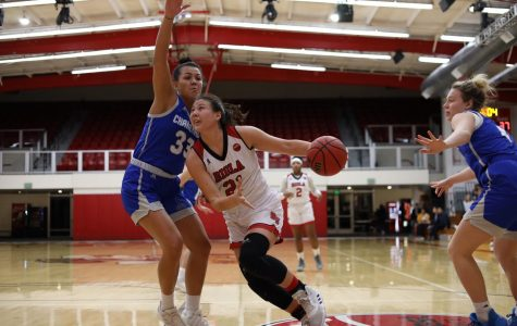 Freshman forward Madi Chang dribbles the ball around her opponent from Chaminade University on February 13th, 2020.