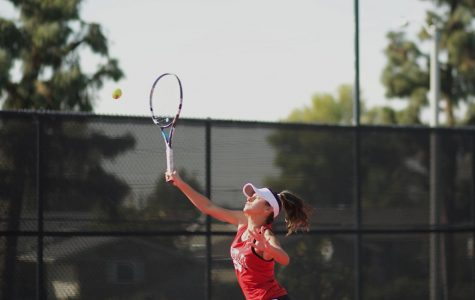 Tennis squeaks by Redlands