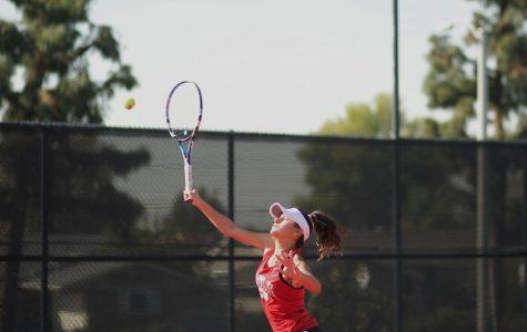 Tennis squeaks by Redlands