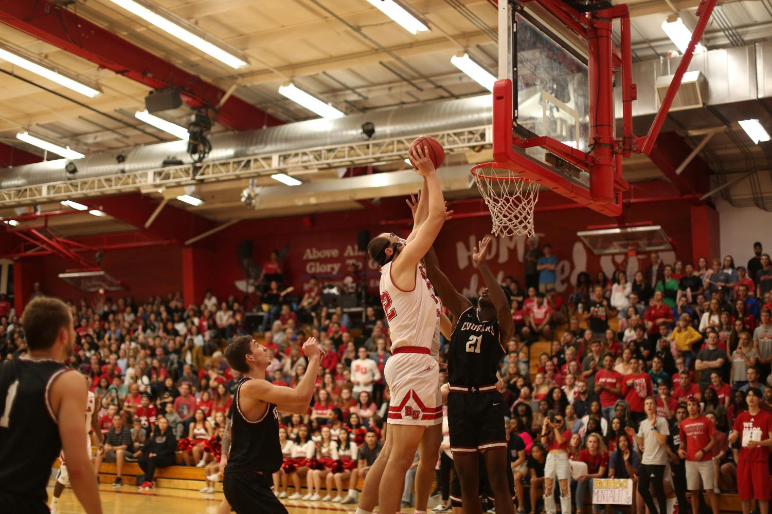 Solomon Ruddell, a sophomore undecided major with a forward position, makes a basket.