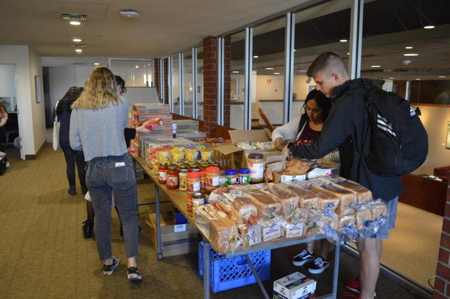 Students stop by the Pop-Up Pantry located in the Student Union Building every Tuesday in order to pick up groceries.